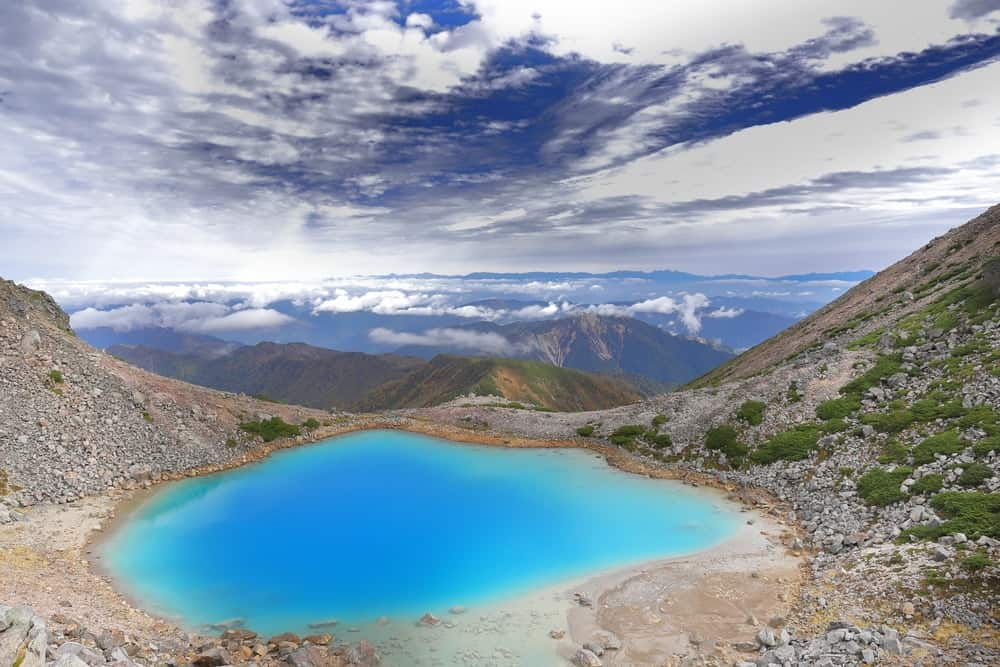 A view of the blue crater and mountains at the Hakusan National Park in Japan.