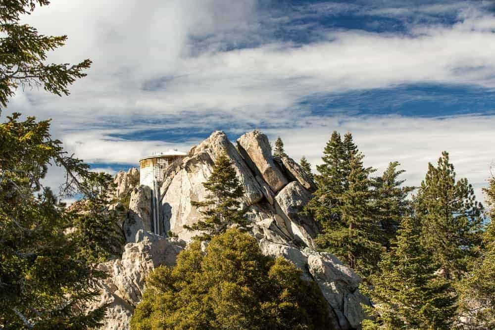 A look at the stone structures of San Jacinto Peak filled with pines.