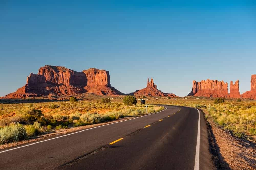 Highway with a backdrop of the scenic Mountain Valley in Arizona, US.