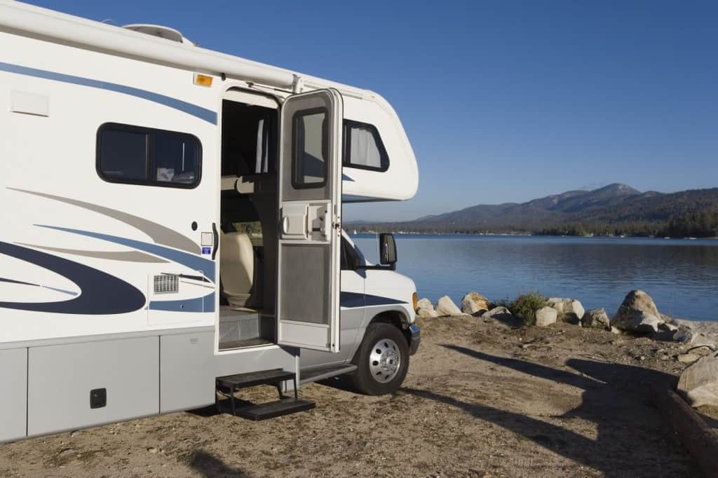 A camper on the shores of a lake.