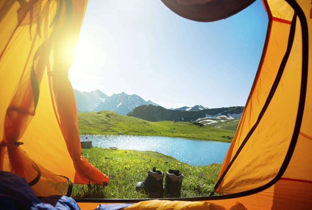 Mountain and lake views as seen from inside a tent.