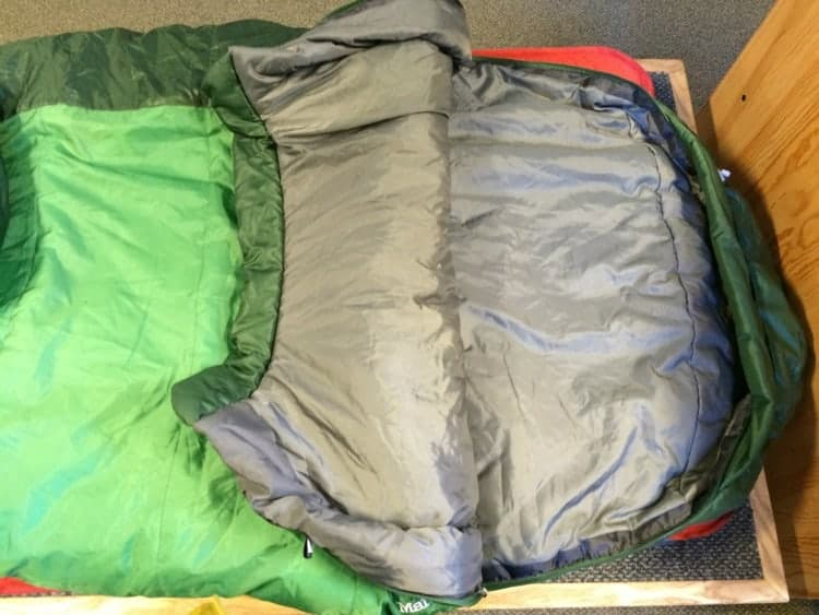 The Marmot Trestles 30 degree synthetic mummy sleeping bag for under $100 showing the inside.