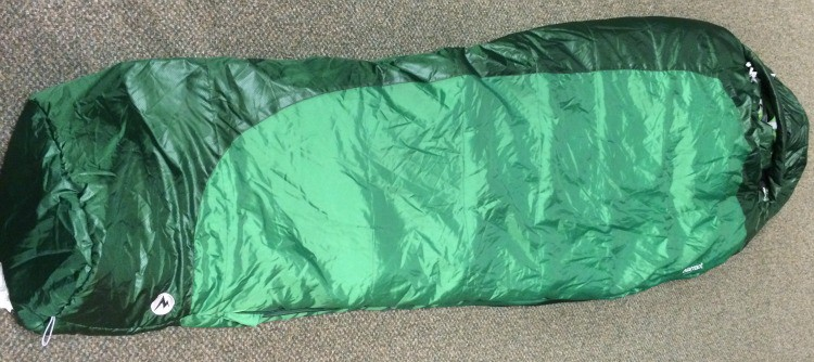 The Marmot Trestles 30 degree synthetic mummy sleeping bag for under $100 with its cover.