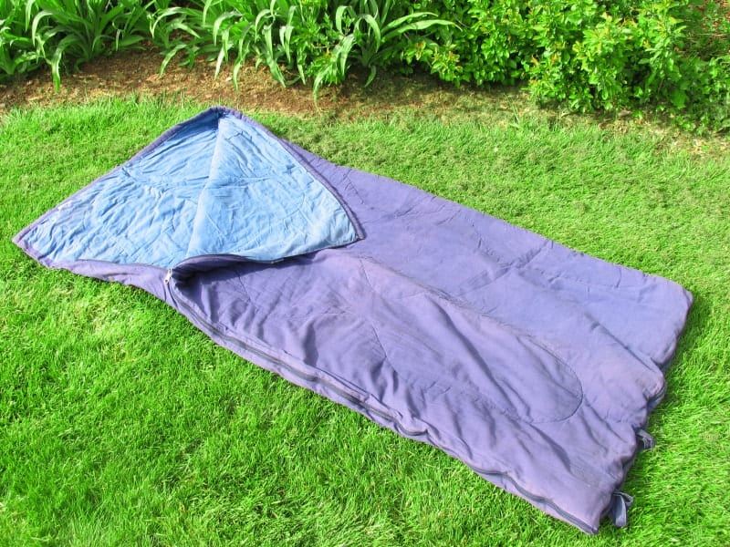 An old sleeping bag on the ground.