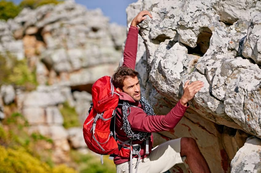 A rock climber with full technical gear.