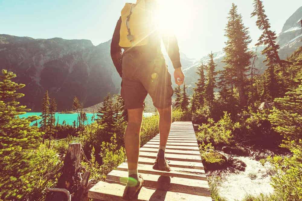 A man hiking near a lake.