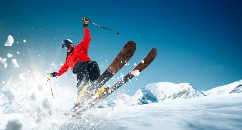 A skier in action wearing a full gear.