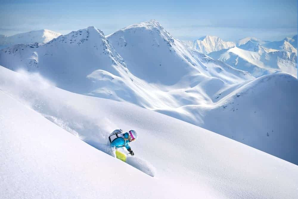 A person skiing down a snowy slope.