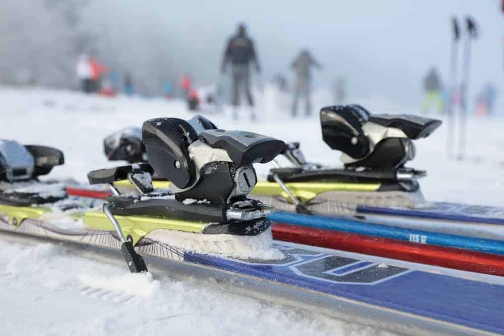 A close look at sets of system skis with bindings.