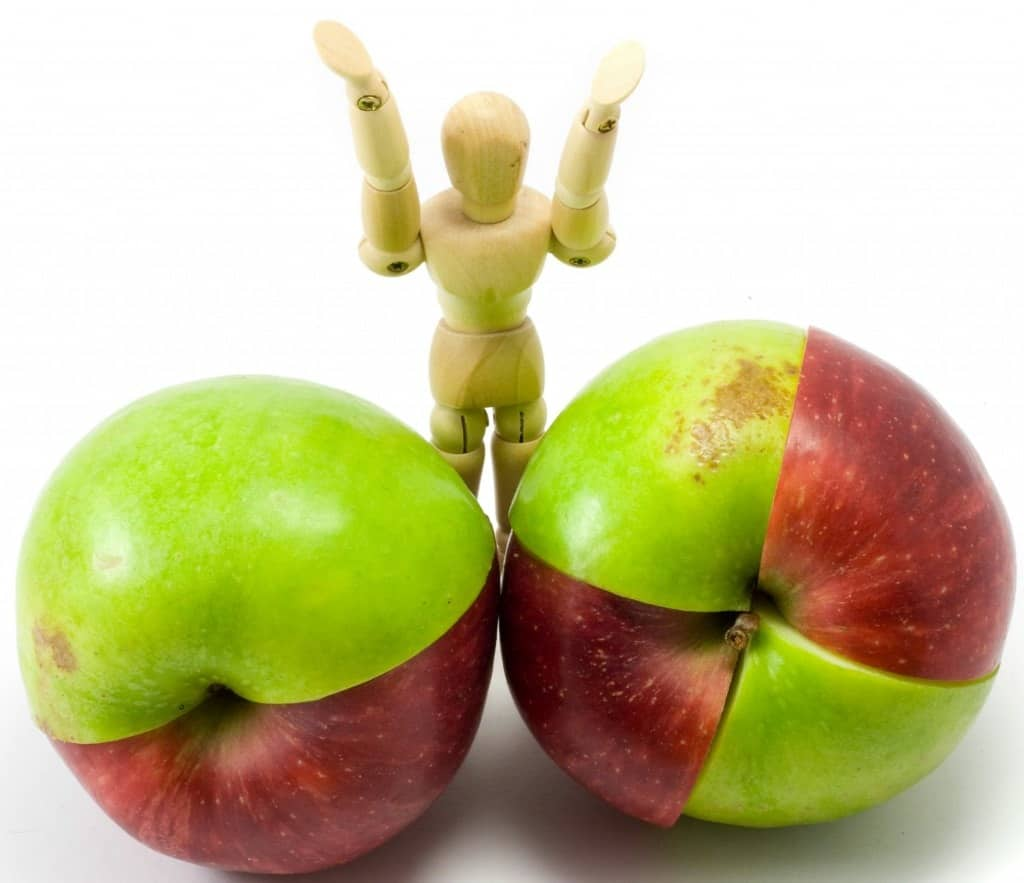 Mixed red and green apples on the white background.