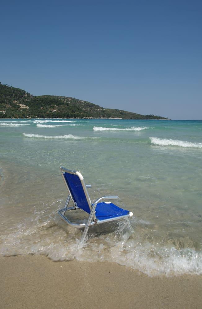 Aluminum beach chair by the seashore.