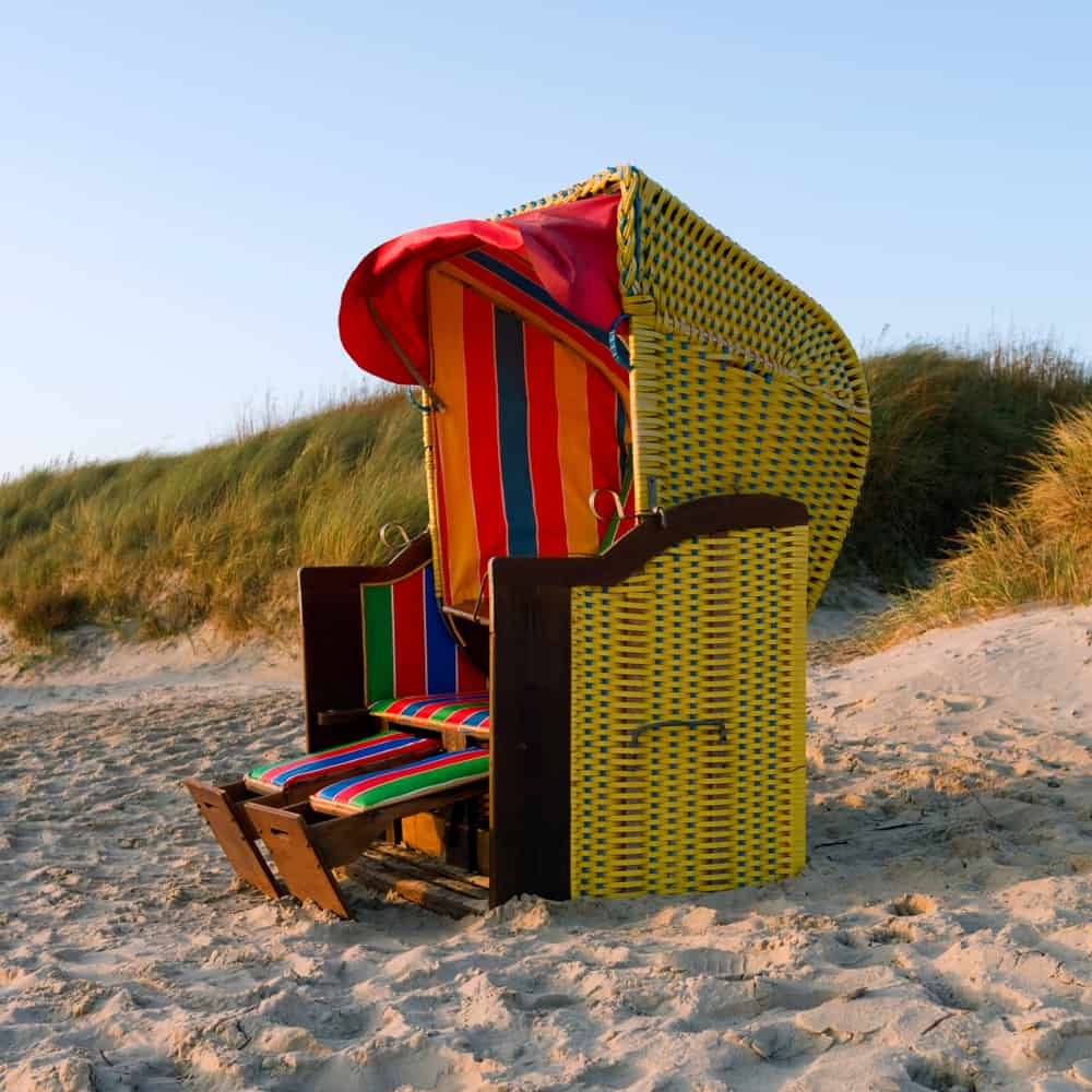 Colorful beach chair with footrest.