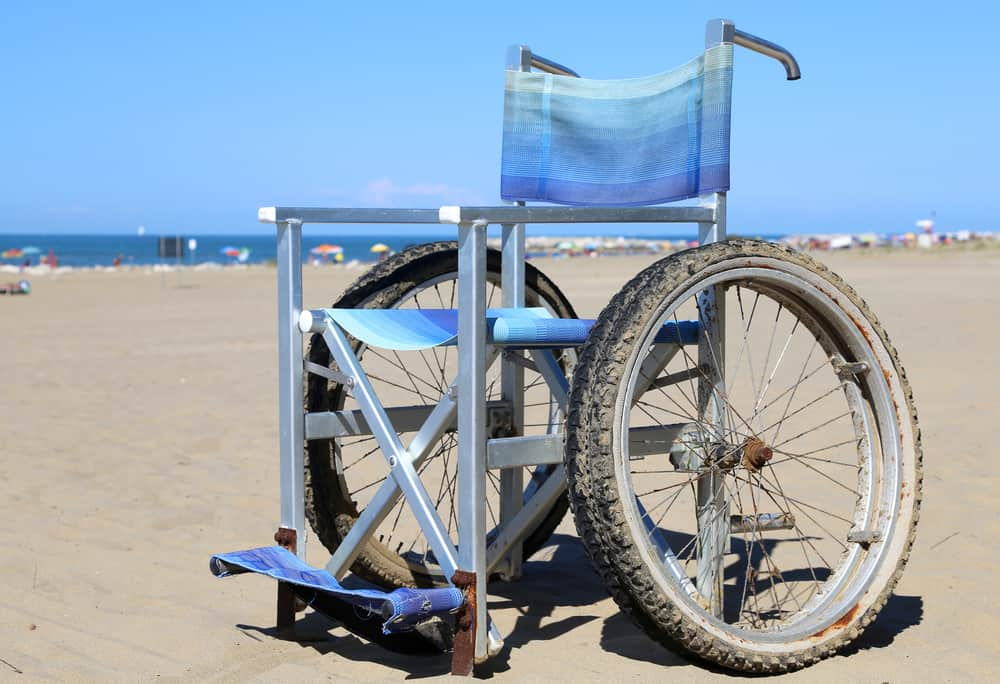Beach chair with wheels on the sand.