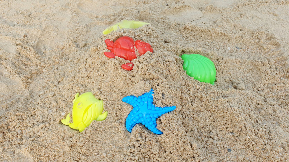 Various castle molds on the sand.
