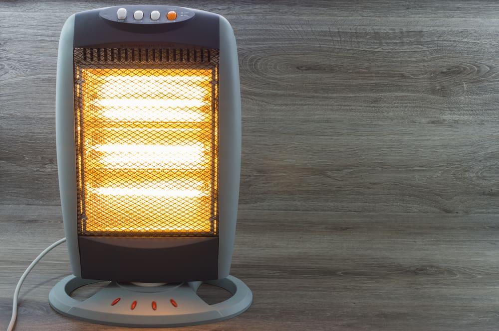 Halogen heater against a wooden background.