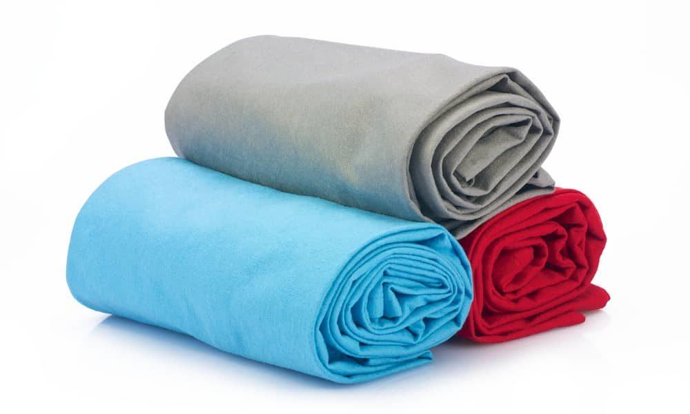 Rolled microfiber beach blanket in multi colors.