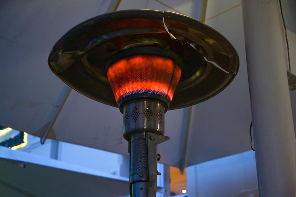 Gas burning propane heater on a patio.