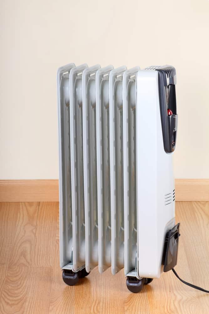 Radiant heater on hardwood floor.