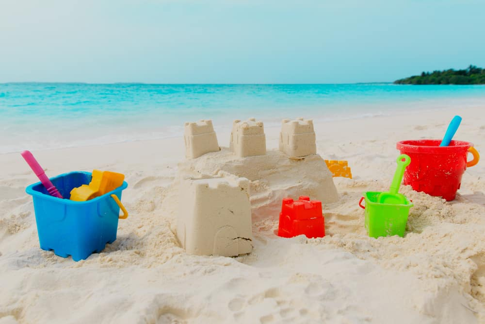 Sand castle with beach toy set.