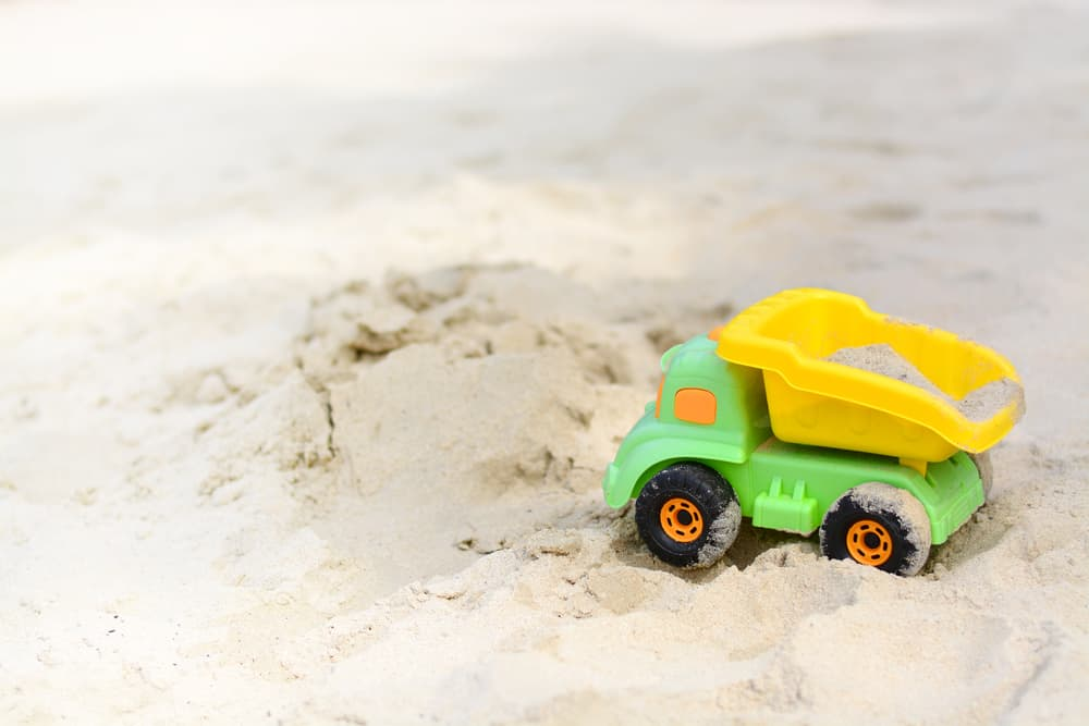 Truck beach toy on the sand.