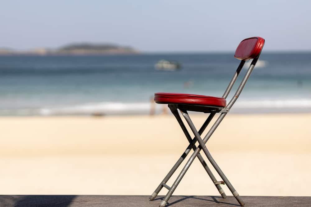 Red steel chair near the beach.