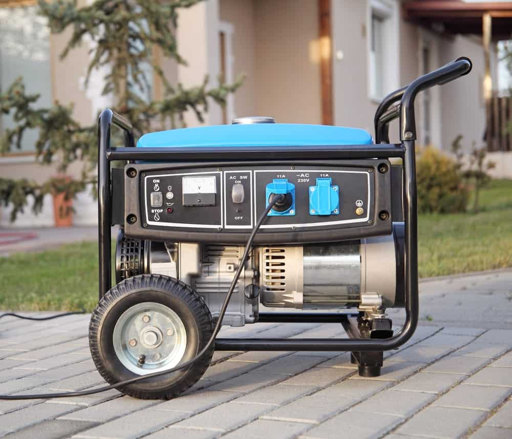 This is a close look at a gas-powered portable generator with wheels.