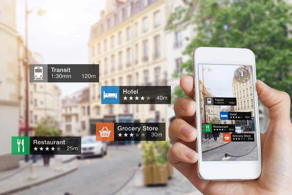 This is a close look at a hand holding a mobile phone that showcases a travel application.