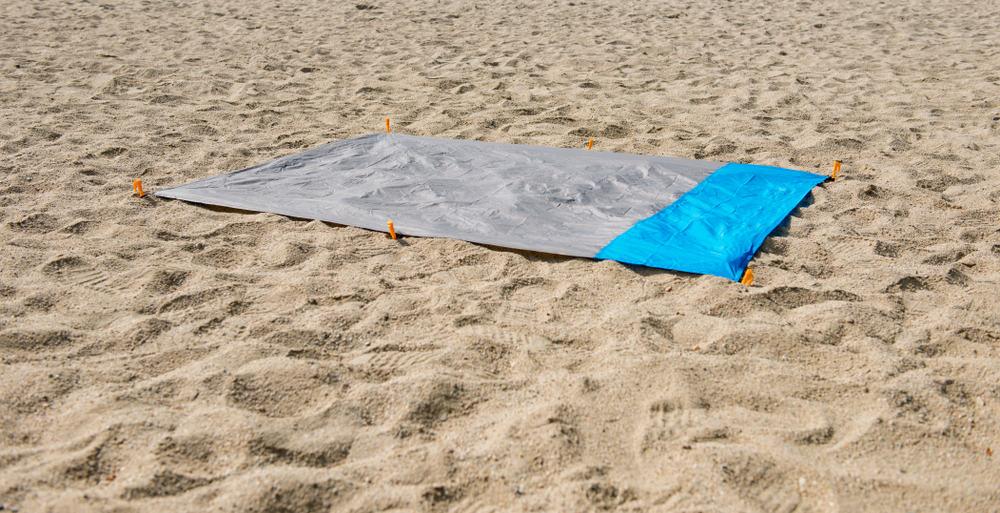 Waterproof blanket on the sand.