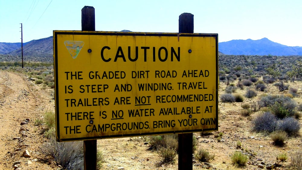 This is a close look at a caution signage warning against trailers and bringing water.