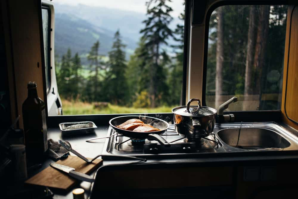 Kitchen unit inside a camper van.