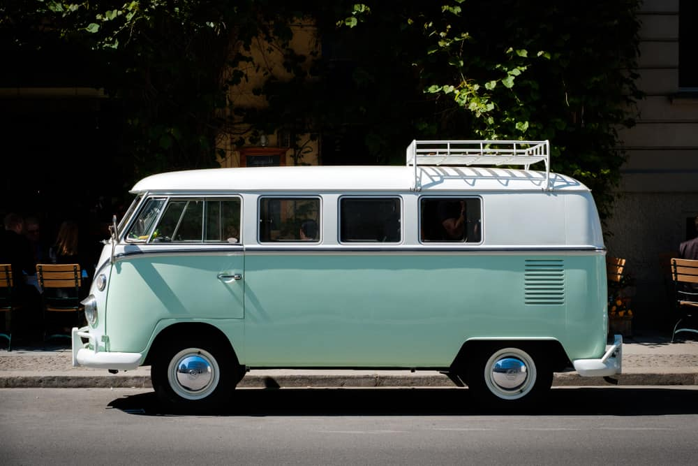 This is a vintage VW T1 BULLI camper with a pastel mint green tone.