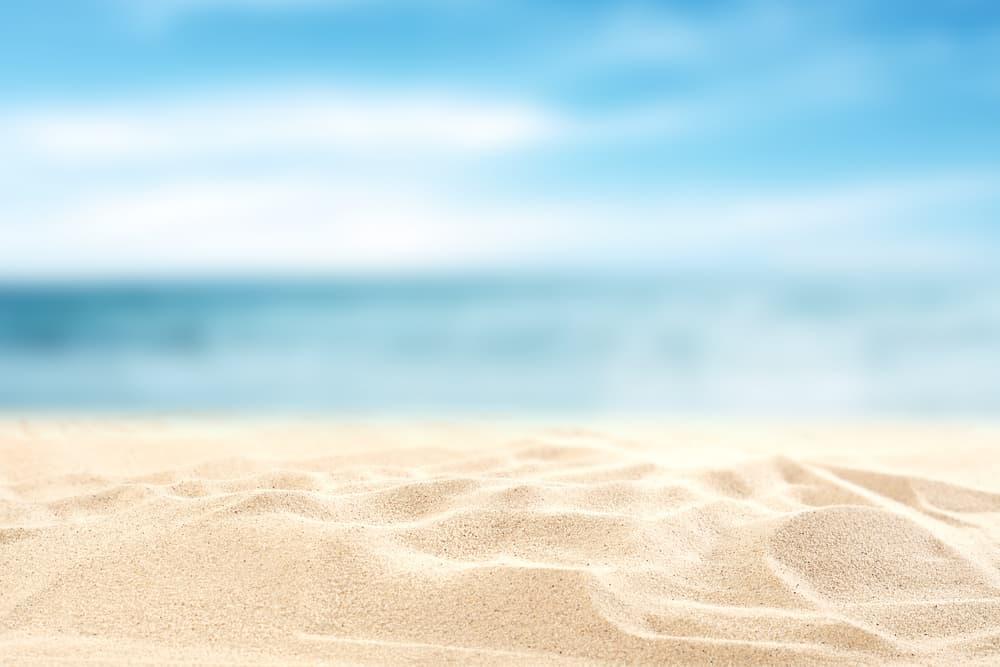 Sea sand under the blue sky.