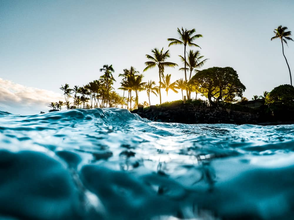 This is a sunrise view of the island of Maui from the vantage of the sea.
