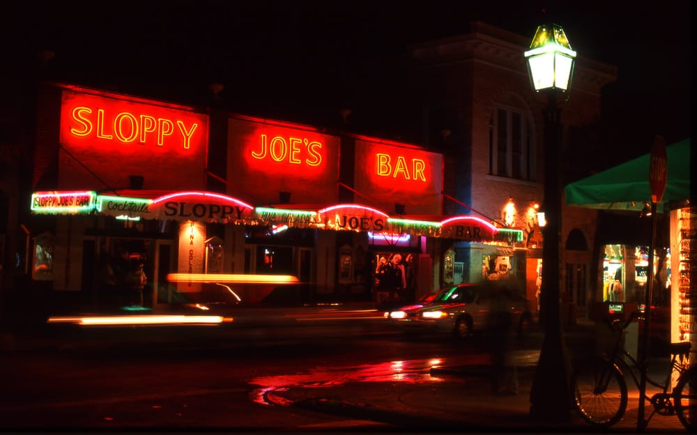 A nighttime view of Sloppy Joes Bar in Key West.