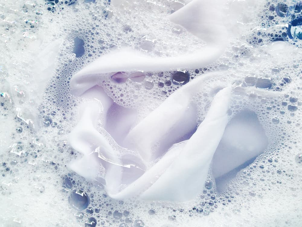 A white cloth soaking in soapy water.