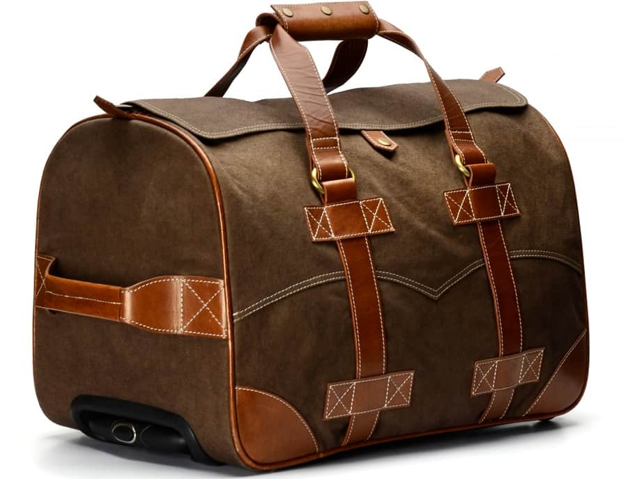 A brown wheeled duffel bag with leather straps.