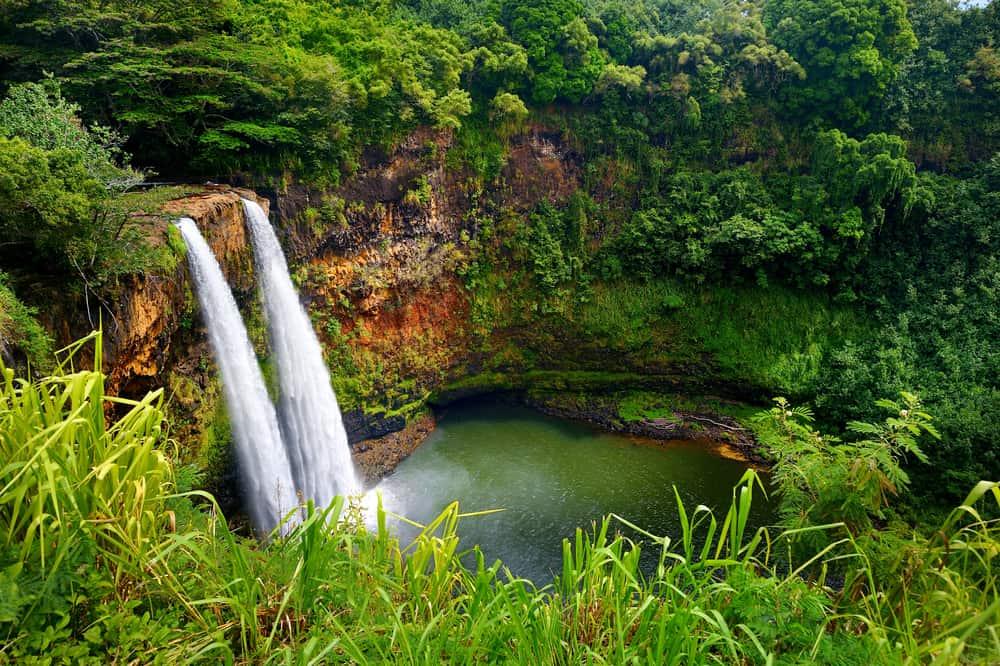 A top view of the twin Wailua waterfalls in Kauai, Hawaii.