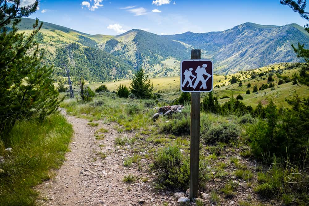 The Eastside Mountain Trail with hiking trail signage.