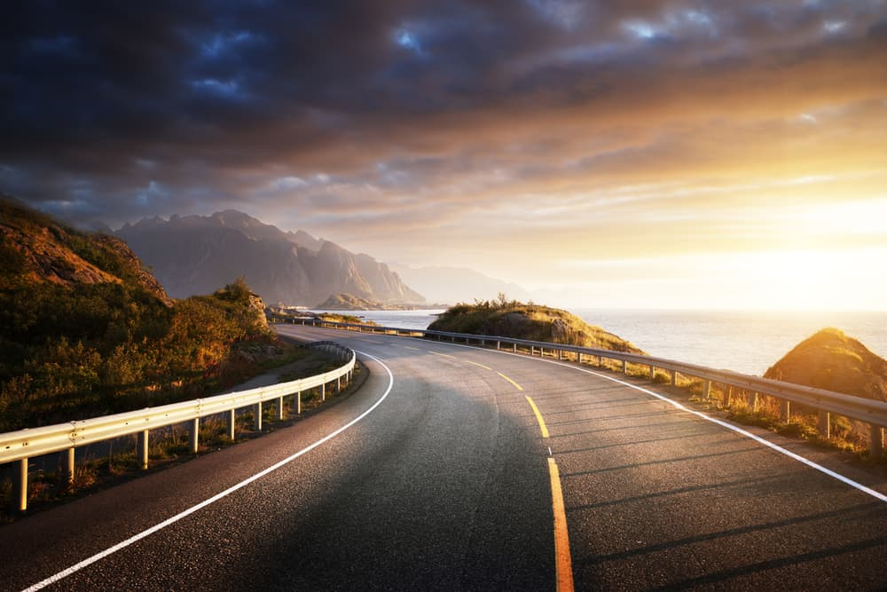 Road by the sea during sunset.